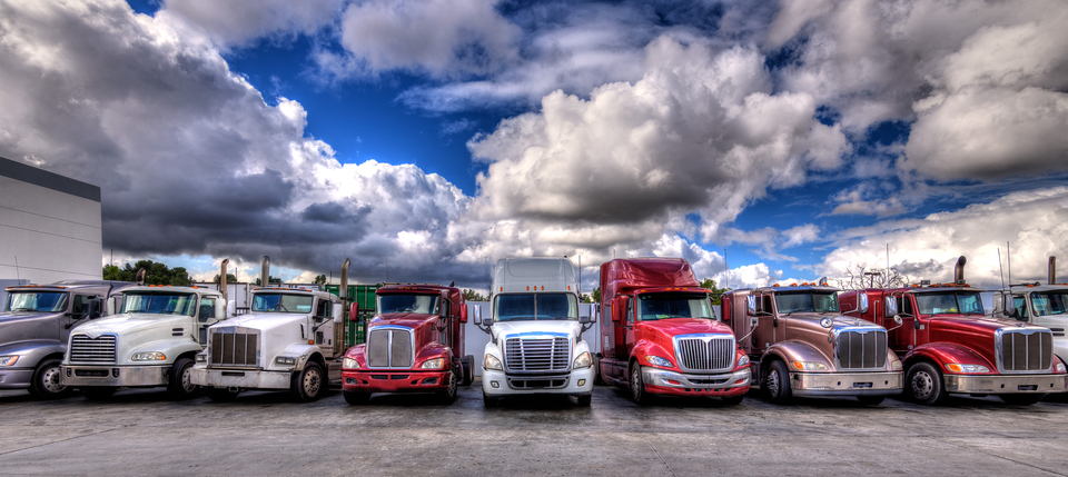 HDR-image-of-Semi-trucks lined-up-on-a-parking-lot
